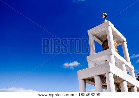 tower of monk Buddist in temple, Thailand, on a bright sunny day with blue sky and copy space for text