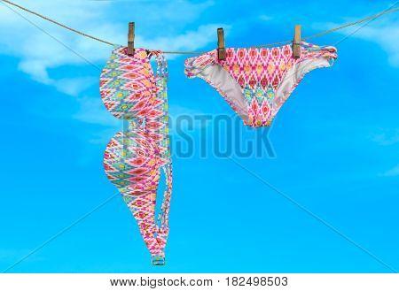 Summer vacation on the beach swimwear on sky background