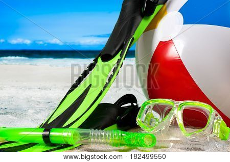 Summer vacation on the seaside beach. Mask goggles with snorkel and flippers on the beach