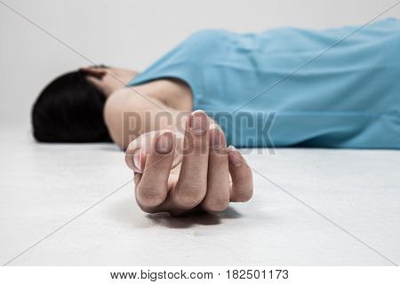 Dead person lying on a floor. Focus at the Hand