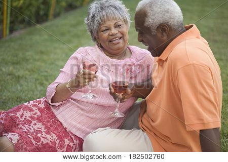 Senior African couple drinking wine