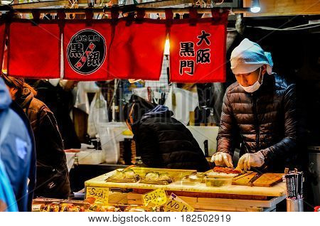 TOKYO,JAPAN - 14 MAR 2017 : View of Tsukiji fish market with retail shops and restaurants carter in Tokyo