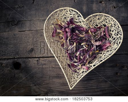 Heart shape of tulip leaves on a rustic wooden table