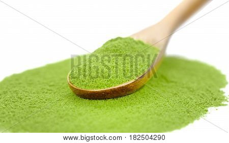 powdered green tea with bamboo spoon isolated on white background