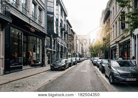 Antwerp Belgium - July 28 2016: Commercial street in Antwerp at sunset with sunlight on background. It is a city in Belgium in the region of Flanders. It has the biggest port in Belgium.