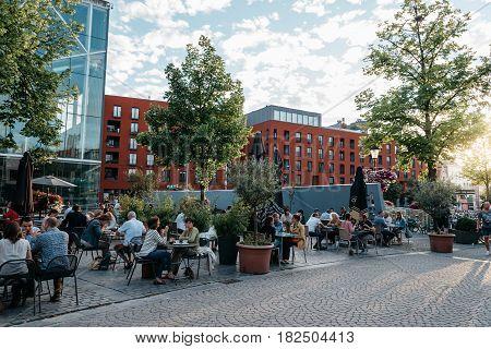 Mechelen Belgium - July 28 2016: Terraces of Restaurants in Mechelen at sunset. It is one of most prominent cities of Belgium in historical art.