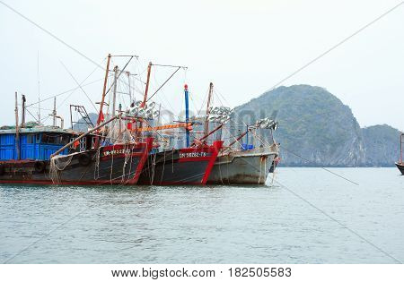 Halong Bay Vietnam - March 6 2017: fishing boat near Cat Ba island Halong Bay Vietnam