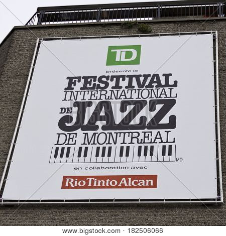 Montreal, Quebec - June 27, 2015 - Square close up view of a large International Jazz Festival sign on a building in downtown Montreal Quebec on a bright day at the end of June.