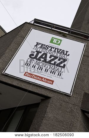 Montreal, Quebec - June 27, 2015 - Vertical close up of a large International Jazz Festival sign on a building slightly skewed for dramatic effect in downtown Montreal, Quebec on a bright day at the end of June.