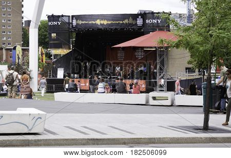 Montreal, Quebec - June 27, 2015 - Wide view of a band setting up onstage for their performance at the International Jazz Festival in downtown Montreal, Quebec on a bright day at the end of June.