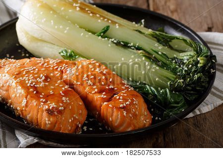 Delicious Glazed Salmon Fillet With Sesame And Bok Choy Close-up. Horizontal