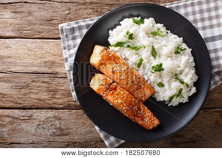 Glazed Salmon Fillet With Rice Garnish Close-up. Horizontal Top View