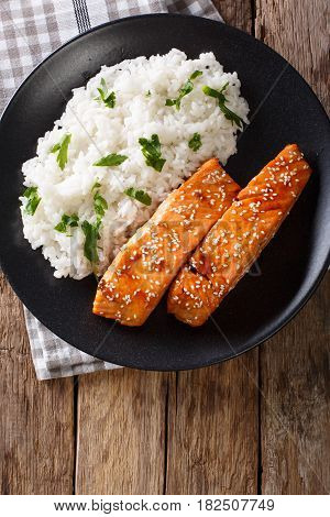 Glazed Salmon Fillet With Rice Garnish Close-up. Vertical Top View