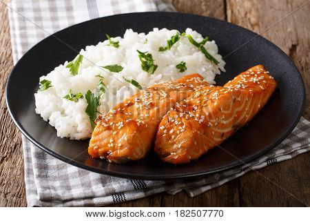 Fried Salmon In A Honey-soy Glaze And Rice Close-up. Horizontal