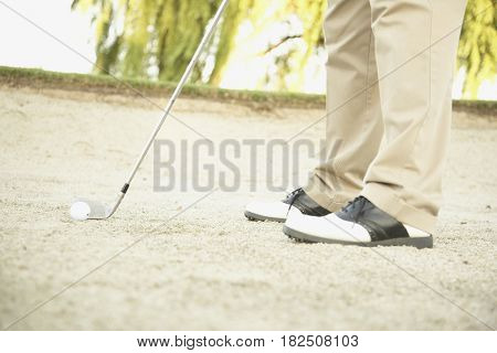 Close up of golfer in sand trap