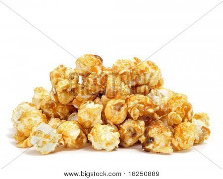 a pile of caramel corn on a white background