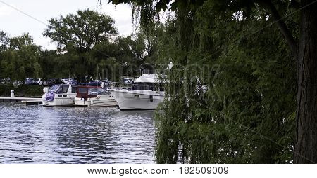 Lachine, Quebec - August 1, 2015 -- Wide view of small yachts docked in the Lachine Canal at Rene Levesque Park, Lachine, Quebec on a sunny day in August.