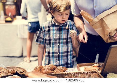 Little Boy Eating Testing Sample Homemade Bread