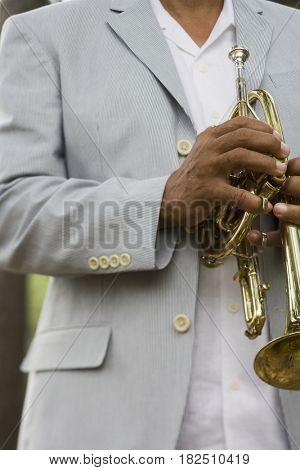 Senior African man holding trumpet