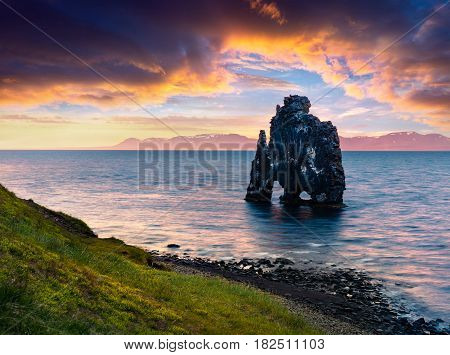 Huge basalt stack Hvtserkur on the eastern shore of the Vatnsnes peninsula. Colorful summer sunrise in northwest Iceland Europe. Artistic style post processed photo.