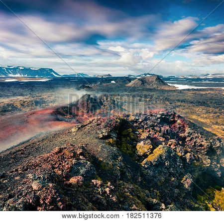 Fields of steamy waters in the Krafla volcano. Colorful exotic landscape with lava ground in the geothermal valley Leirhnjukur located near Lake Myvatn in north of Iceland Europe. Artistic style post processed photo.