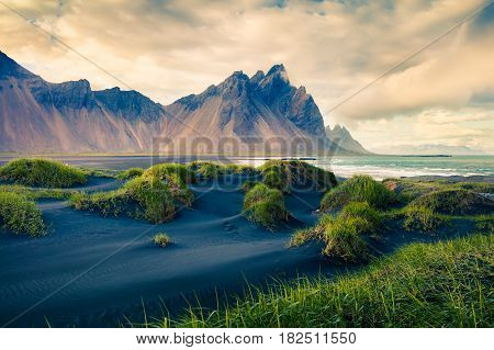 Black sand dunes on the Stokksnes headland on southeastern Icelandic coast. Colorful evening landscape in the Iceland Europe. Retro style filtered.