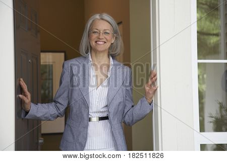 Portrait of middle-aged woman in doorway