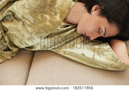 High angle view of woman sleeping