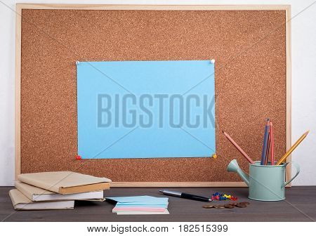 note on board on the desk with books, pens and money, suitable for bussines, marketing, work and home enviroment.