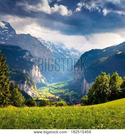 Dramatic rainy view of Lauterbrunnen village. Beautiful outdoor scene in Swiss Alps Bernese Oberland in the canton of Bern Switzerland Europe. Artistic style post processed photo.