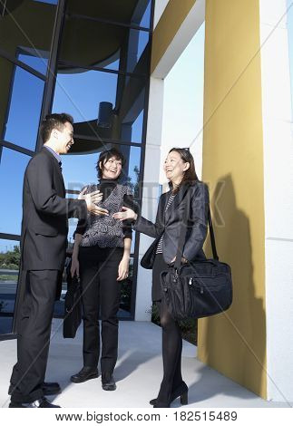 Asian businesspeople talking outdoors