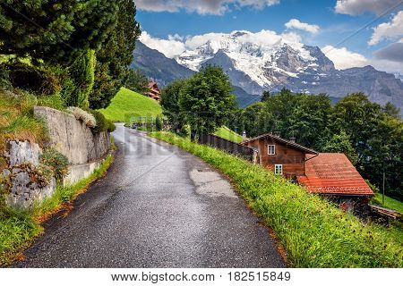 Colorful summer view of Wengen village. Beautiful outdoor scene in Swiss Alps Bernese Oberland in the canton of Bern Switzerland Europe. Artistic style post processed photo.