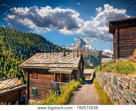 Sunny summer morning in Zermatt village with Matterhorn (Monte Cervino Mont Cervin) peak on backgroud. Beautiful outdoor scene in Swiss Alps Valais canton Switzerland Europe.