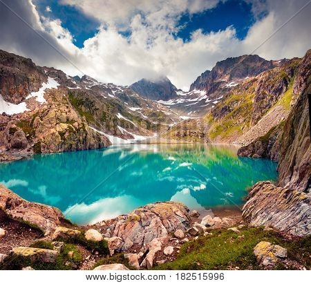 Colorful summer morning on the Lac Blanc lake with Belvedere peack on background Chamonix location. Beautiful outdoor scene in Vallon de Berard Nature Preserve Graian Alps France Europe.