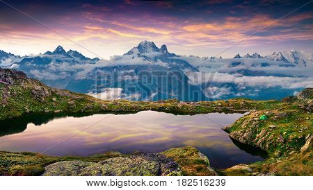 Colorful summer sunrise on the Lac Blanc lake with Mont Blanc (Monte Bianco) on background Chamonix location. Beautiful outdoor scene in Vallon de Berard Nature Preserve Graian Alps France Europe.