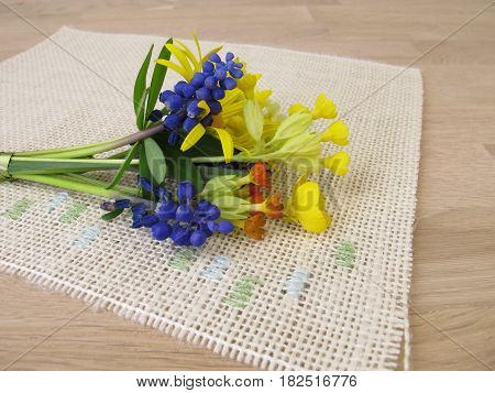 Small arranged spring bouquet with flowers on table