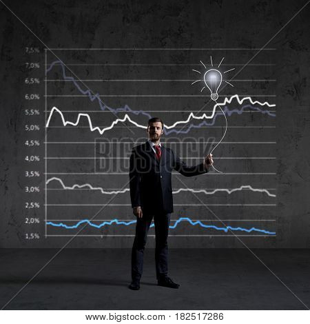 Businessman standing over diagram background. Business, finance, investment concept.