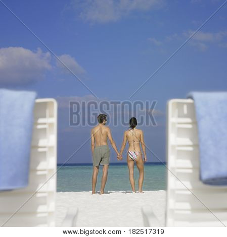 Couple holding hands at beach