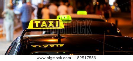 Taxi sign on a car at night