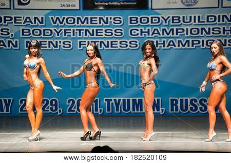 Tyumen, Russia - May 28, 2011: European Women Bodybuilding, Fitness, Bodyfitness, Bikini and Men Fitness Championships. Prejudging. Morning session