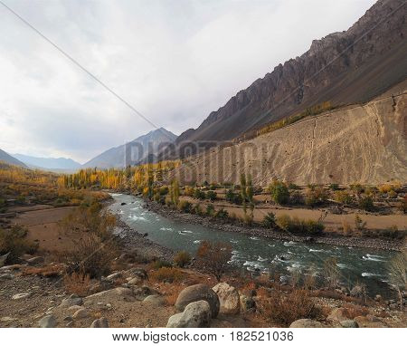 Golden Autumn Mountains And Lake Along Hindu Kush Mountain Range In Ghizer Valley, Northern Pakistan