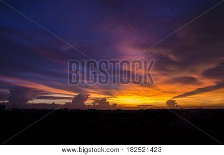 twilight sunset sky and color clouds in city scape