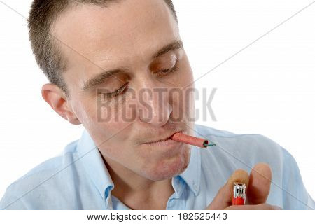 A funny young man smoking a firecracker on white