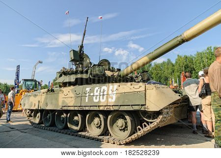 Nizhniy Tagil, Russia - July 12. 2008: Visitors examine military equipment on exhibition range. T80U modernized tank. Russian Arms Expo