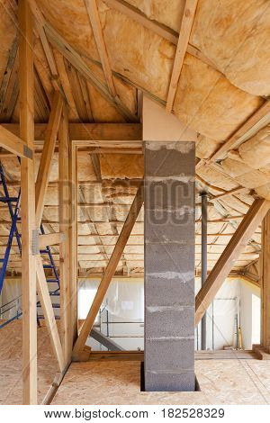 Atiic with environmentally friendly and energy efficient thermal insulation rockwool. Wooden Roof Frame House Construction