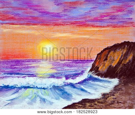 Beautiful sunset on the sea. The waves rolled on the rocky shore