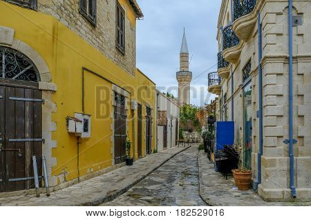 Mosque with minaret in street scene in old town Limassol.