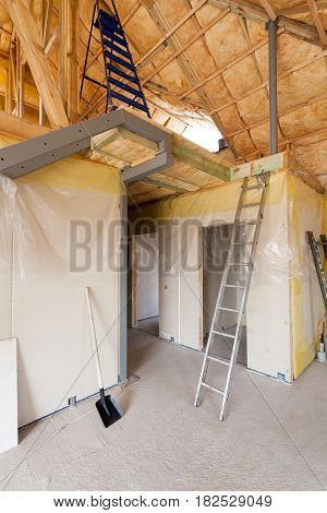 A room at a newly constructed home is sprayed with liquid insulating foam