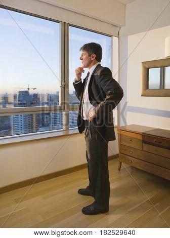 Businessman standing next to window