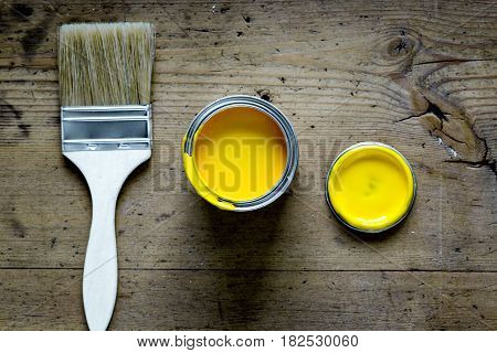 builder work with professional repairing implements set for decorating and painting on wooden background top view mock-up